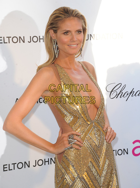 Heidi Klum (wearing Julien Macdonald).The 21st Annual Elton John AIDS Foundation Academy Awards Viewing Party held at The City of West Hollywood Park in West Hollywood, California, USA..February 24th, 2013.oscars half length gold diamante sequins sequined dress beads beaded art deco plunging neckline cleavage hands on hips rings .CAP/DVS.©DVS/Capital Pictures.