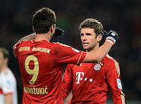 FUSSBALL   1. BUNDESLIGA  SAISON 2012/2013   19. Spieltag   VfB Stuttgart  - FC Bayern Muenchen      27.01.2013 JUBEL FC Bayern; Torschuetze zum 0-2 Thomas Mueller (re) umarmt von Mario Mandzukic