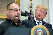 US President Donald J. Trump (R) listens to Scott Sauritch (L), maintenance worker at Irvin Works and  President of Local Union 2227; before signing a presidential proclamation on steel and aluminum tariffs, in the Roosevelt Room of the White House in Washington, DC, USA, 08 March 2018. President Trump is imposing tariffs on steel and aluminum imports. A decision to impose the tariffs on Canada or Mexico will not be decided until negotiations on the North American Free Trade Agreement (NAFTA).<br /> Credit: Michael Reynolds / Pool via CNP