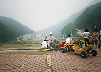 China / Henan Province / Fu Niu Shan / 22.6.2013 / People from the Muslim community of Luoyang take a rest on their way to the top of Fu Niu Mountain, where they go for spiritual travel. © Giulia Marchi