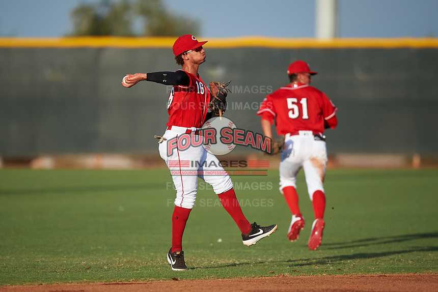 AZL Reds second baseman Sebastian Almonte (16) makes a leaping throw to first base during an Arizona League game against the AZL Athletics Green on July 21, 2019 at the Cincinnati Reds Spring Training Complex in Goodyear, Arizona. The AZL Reds defeated the AZL Athletics Green 8-6. (Zachary Lucy/Four Seam Images)