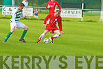 He's Back: Tralee Dynamos midfielder.James Sugrue, just returned from a season.with Lisselton Rovers, shields the ball from.Listowel Celtic's Kevin Bambury.