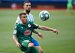 Ager Aketxe (RC Deportivo de la Coruna) and Tete Morente (Malaga CF) competes for the ball during La Liga Smartbank match round 39 between Malaga CF and RC Deportivo de la Coruna at La Rosaleda Stadium in Malaga, Spain, as the season resumed following a three-month absence due to the novel coronavirus COVID-19 pandemic. Jul 03, 2020. (ALTERPHOTOS/Manu R.B.)