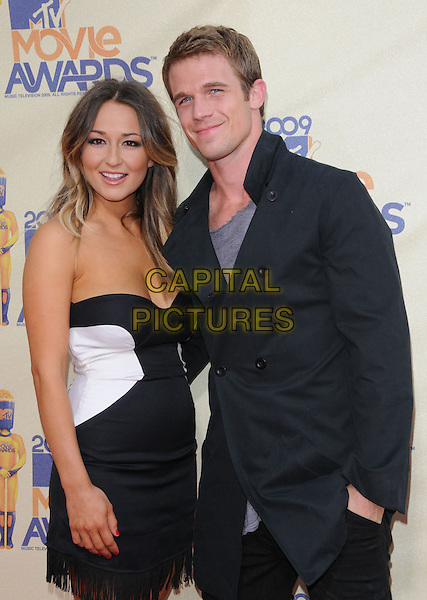 DOMINIQUE GEISENDORFF & CAM GIGANDET.The 2009 MTV Movie Awards held at Universal Ampitheatre  in Universal City, California, USA..May 31st, 2009  .half length black suit white dress strapless couple blue jacket.CAP/DVS.©Debbie VanStory/Capital Pictures.