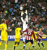 CARSON, CA – APRIL 9, 2011: Columbus Crew goalie William Hesmer (1) goes up to make a save during the match between Chivas USA and Columbus Crew at the Home Depot Center, April 9, 2011 in Carson, California. Final score Chivas USA 0, Columbus Crew 0.