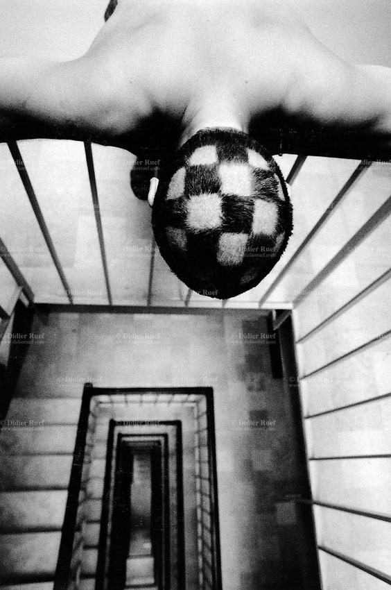 Switzerland. Geneva. Head of my friend Lorenzo Menoud. Checkerboard's haircut. © 1988 Didier Ruef