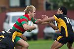 Ethan James gets tackled by Robert Wallis and Ioane Ioane. Counties Manukau Premier Club Rugby game between Waiuku and Bombay, played at Waiuku on Saturday July 5th 2010. Waiuku won 59 - 14 after trailing 12 - 14 at halftme.