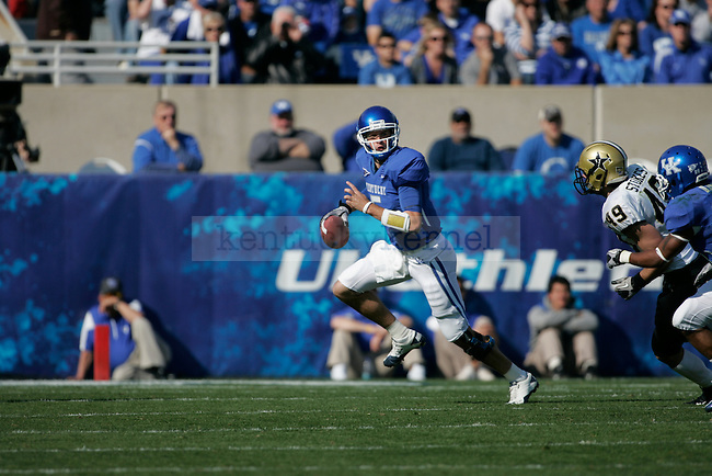 Uk's Mike Hartline scrambles during the first half of the University of Kentucky's game against Vanderbilt  at Commonwealth Stadium in Lexington, Ky., on 11/13/10. UK won the game 38-20. Photo by Mike Weaver | Staff