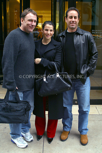 Comedian Jerry Seinfeld with his wife Jessica and comedian Colin Quinn pictured outside Barneys New York on Madison Avenue after they spent some time inside the store but bought nothing. New York, October 15, 2002. Please byline: Alecsey Boldeskul/NY Photo Press.   ..*PAY-PER-USE*      ....NY Photo Press:  ..phone (646) 267-6913;   ..e-mail: info@nyphotopress.com