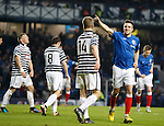 Andy Little celebrates the fourth goal for Rangers as Queen's Park players are gutted