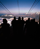 ARGENTINA, Bariloche, Cerro Cathedral, silhouetted of people traveling by ski lift