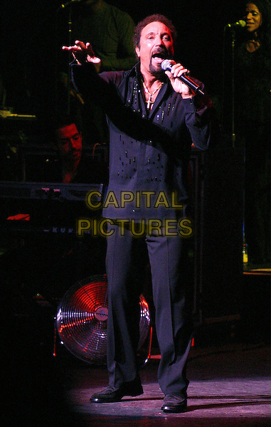TOM JONES.returns To The Apollo Theater As Part Of The 70 Year Anniversary Celebration, New York City.7 March 2004 .full length, full-length, music, singing, stage.www.capitalpictures.com.sales@capitalpictures.com.©Capital Pictures.