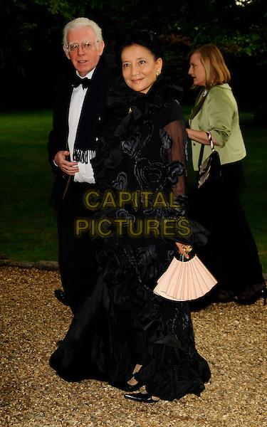 JUNG CHANG & GUEST.At the Russia Midsummer Fantasy, in aid of the Raisa Gobachev Foundation, Stud House, Home Park, Hampton Court, England, UK, 7th June 2008. .arrivals full length black dress fan ruffles .CAP/CAN.©Can Nguyen/Capital Pictures