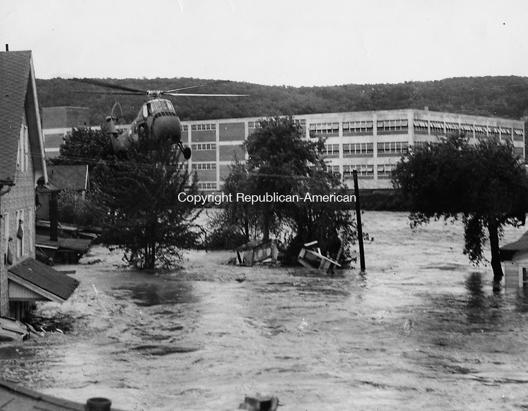 A Sikorsky helicopter operating near South Main and Hotchkiss Streets in Naugatuck, during the flood.