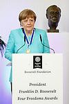 German Chancellor Angela Merkel speaks after receiving the International Four Freedoms Award at the Nieuwe Kerk in Middelburg, The Netherlands, April 21, 2016. REUTERS/Michael Kooren