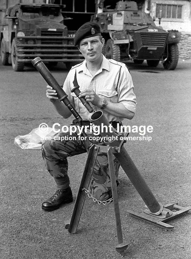 Colonel Malcolm Mackenzie-Orr, RAOC, Royal Army Ordnance Corps, demonstrating a Provisional IRA DIY rocket launcher captured in a planned search in Belfast, N Ireland, UK. The weapon was constructed from lavatory pipes and joints as used by plumbers. A few months later Mackenzie-Orr defused a massive van bomb beside a Belfast telephone exchange for which he was awarded the George Cross. After he had foiled the attempt to destroy the exchange, it was feared he might become a terrorist target and he was re-assigned to the weapons research establishment in Woomera, South Australia. He left the military having achieved the rank of brigadier. He died 16th December 2007 in Australia. 197307050472b.<br />