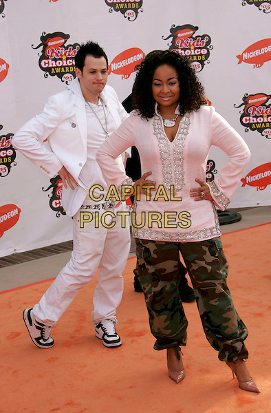 JOEL MADDEN & RAVEN SYMONE.Attends Nickelodeon's 18th Annual Kids' Choice Awards Show held at UCLA's Pauley Pavilion in Westwood, California, April 2nd 2005..full length white smock long top tunic combat army print trousers funny pose white suit hands on hips.Ref: DVS.www.capitalpictures.com.sales@capitalpictures.com.©DVS/Capital Pictures