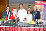 COOKING: Kevin Dundon getting an helping hand in the kitchen at The Garveys Supervalu Food and Wine Fair, in The Carlton Hotel,m Tralee on Thursday njight, L-r: Kevin O'Connor, Santa, Kevin Dundon,           and Mark Bennett(president of Tralee Lions Club).. . ............................... ..........