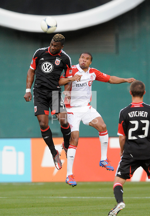 D.C. United defender Brandon McDonald (4) goes up to head the ball against Toronto FC forward Ryan Johnson (9) D.C. United defeated Toronto FC 3-1 at RFK Stadium, Saturday May 19, 2012.