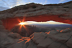 Sunrise at Mesa Arch in Canyonlands National Park, Utah, USA. .  John offers private photo tours in  Canyonlands National Park and throughout Utah and Colorado. Year-round.