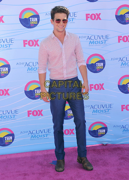 Daren Kagasoff.FOX's 2012 Teen Choice Awards held at The Gibson Ampitheatre in Universal City, California, USA..July 22nd, 2012.full length white pink shirt blue trousers sunglasses shades .CAP/RKE/DVS.©DVS/RockinExposures/Capital Pictures.