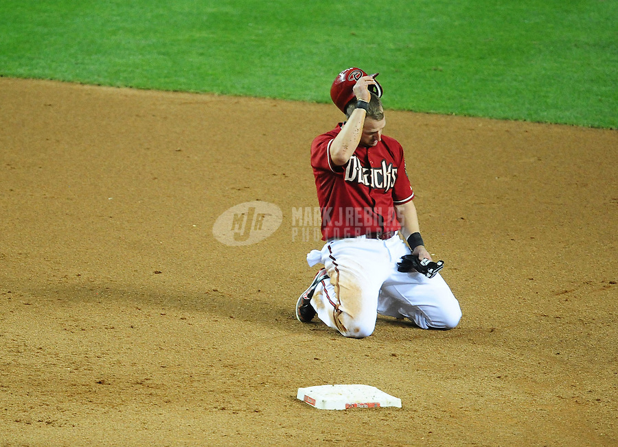 May 9, 2012; Phoenix, AZ, USA; Arizona Diamondbacks base runner Willie Bloomquist reacts after being forced out at second base in the fifth inning against the St. Louis Cardinals at Chase Field. Mandatory Credit: Mark J. Rebilas-