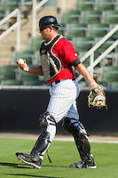 Kannapolis Intimidators catcher Brent Tanner (23) retrieves the ball during the South Atlantic League game against the Savannah Sand Gnats at CMC-Northeast Stadium on May 30, 2013 in Kannapolis, North Carolina. The Sand Gnats defeated the Intimidators 8-2 in the completion of a game that was suspended on May 3, 2013 in Savannah, Georgia.   (Brian Westerholt/Four Seam Images)