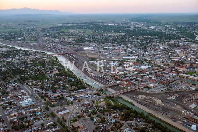 Dusk aerial of downtown Pueblo, Colorado with Arkansas River