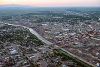 Dusk aerial of downtown Pueblo, Colorado with Arkansas River