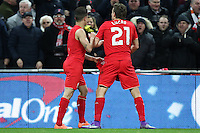 Philippe Coutinho of Liverpool celebrates scoring his team's first goal against Manchester City to make it 1-1 with Lucas Leiva of Liverpool (right) during the Capital One Cup match between Liverpool and Manchester City at Wembley Stadium, London, England on 28 February 2016. Photo by David Horn / PRiME Media Images.