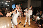 Dancers perform in outfits from the Cristina Ruales Spring Summer 2017 collection fashion show in INGLOT Pro Studio in New York City, on September 11 2016, during New York Fashion Week Spring Summer 2017.