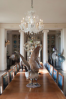 A Canada goose in the centre of the dining table flaunts its plumage (and jewellery) beneath a crystal chandelier