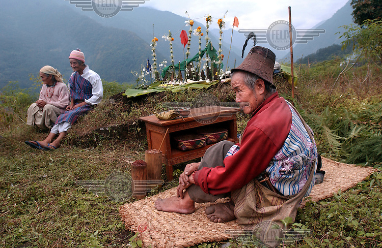 """Lepcha villagers make offerings during a """"puja"""",  or prayer, to the Kanchanjunga mountain, the third highest peak in the world in Dzongu, North Sikkim."""