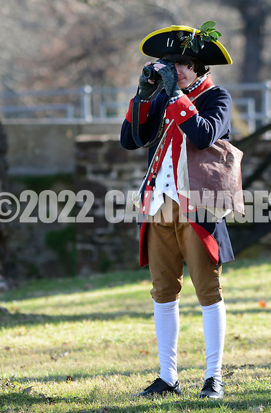 WASHINGTON CROSSING, PA - DECEMBER 7:  Re-enactor Liam Keen, of Smyrna, Delaware makes a picture with his modern era camera during a dress rehearsal for the crossing of the Delaware River at Washington Crossing State Park December 7, 2014 in Washington Crossing, Pennsylvania.  The dress rehearsal is held annually, about two weeks before the Christmas Day reenactment. (Photo by William Thomas Cain/Cain Images)