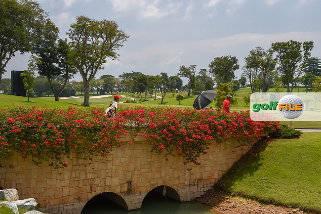 Players cross the bridge as they approach the tee on 16 during Rd 1 of the Asia-Pacific Amateur Championship, Sentosa Golf Club, Singapore. 10/4/2018.<br /> Picture: Golffile | Ken Murray<br /> <br /> <br /> All photo usage must carry mandatory copyright credit (© Golffile | Ken Murray)