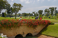 Players cross the bridge as they approach the tee on 16 during Rd 1 of the Asia-Pacific Amateur Championship, Sentosa Golf Club, Singapore. 10/4/2018.<br /> Picture: Golffile | Ken Murray<br /> <br /> <br /> All photo usage must carry mandatory copyright credit (&copy; Golffile | Ken Murray)