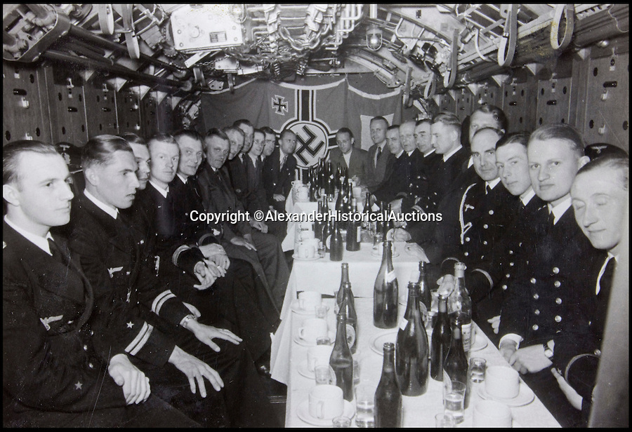 BNPS.co.uk (01202 558833)<br /> Pic: AlexanderHistoricalAuctions/BNPS<br /> <br /> German officers enjoy bottles of beer.<br /> <br /> Fascinating images which provide a snapshot of life on a German U-Boat have been unearthed.<br /> <br /> Interestingly, the photographs give us an insight into joyous occasions on the U-976 destroyer including alcohol fuelled parties and gatherings in the mess hall.<br /> <br /> The photo album which was collated by First Officer Lieutenant Wilhelm Hinrichs has now emerged for auction and is tipped to sell for £1,200.<br /> <br /> The U-976 was sunk on March 25, 1944, just a few months before the Normandy landings, near St Nazaire in France by gunfire from two British Mosquito fighter-bombers.