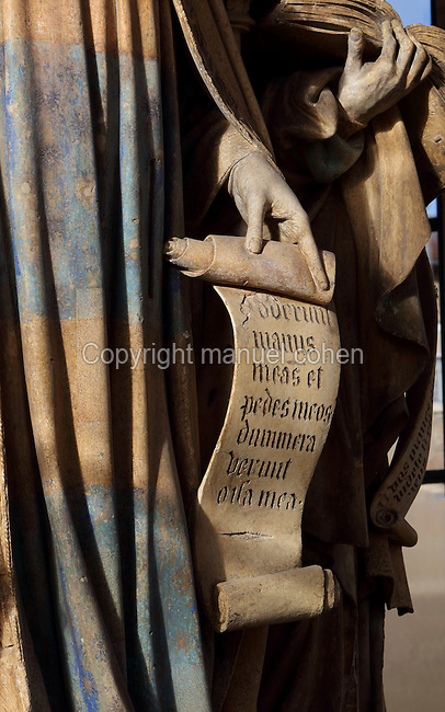 Detail of King David's hand holding a psalm on a scroll, from the Puits de Moise, or Well of Moses, 1395-1403, sculpted by Claus Sluter, 1340-1406, and his studio, and painted by Jean Malouel, 1365-1415, in the courtyard of the Chartreuse de Champmol, the burial site of Philippe le Hardi duc de Bourgogne, or Philip the Bold Duke of Burgundy, now the Hospital de la Chartreuse, Dijon, Burgundy, France. The sculpture was commissioned by Jean sans Peur or John the Fearless, and consists of a crucifixion scene surrounded by 6 prophets (Moses, David, Jeremiah, Zachariah, Daniel and Isaiah), with 6 weeping angels. The hexagonal building surrounding the sculpture was added in the 17th century. Picture by Manuel Cohen