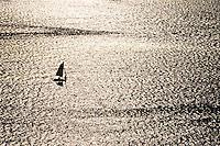 Aerial of sailboat on glistening water. Narragansett Bay, Bristol / Portsmouth, Rhode Island.