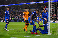 Sol Bamba of Cardiff City is helped to his feet by Nathaniel Mendez-Laing and Anthony Pilkington at full time of the Sky Bet Championship match between Cardiff City and Wolverhampton Wanderers at the Cardiff City Stadium, Cardiff, Wales on 6 April 2018. Photo by Mark  Hawkins / PRiME Media Images.