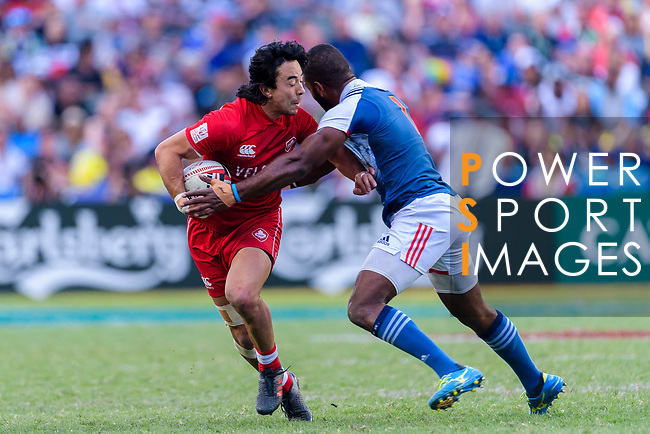Nathan Hirayama of Canada (L) is tackled by Tavite Veredamu of France (R) during the HSBC Hong Kong Sevens 2018 Bowl Final match between Canada and France on 08 April 2018, in Hong Kong, Hong Kong. Photo by Marcio Rodrigo Machado / Power Sport Images