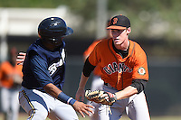 San Francisco Giants shortstop Jameson Henning (8) tags out Sthervin Matos (13) in a run down during an Instructional League game against the Milwaukee Brewers on October 10, 2014 at Maryvale Baseball Park Training Complex in Phoenix, Arizona.  (Mike Janes/Four Seam Images)