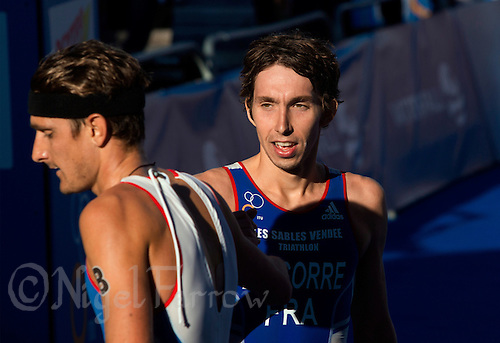 25 AUG 2013 - STOCKHOLM, SWE - Pierre Le Corre (FRA) congratulates Laurent Vidal (FRA), both of France, on his finish at the men's ITU 2013 World Triathlon Series round in Gamla Stan, Stockholm, Sweden (PHOTO COPYRIGHT © 2013 NIGEL FARROW, ALL RIGHTS RESERVED)