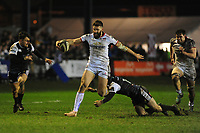 Stuart McCloskey of Ulster evades the tackle of Sam Davies of Ospreys during the Guinness Pro14 Round 15 match between the Ospreys and Ulster Rugby at Morganstone Brewery Field in Bridgend, Wales, UK. Friday 15 February 2019