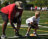 Gary Brown, a 1989 graduate of Brentwood High School who played as an offensive lineman on the Super Bowl-winning 1996 Green Bay Packers, shows stance technique to Alex Tomalski, 9, of New Hyde Park during the Long Island Youth Football Player Academy at Cedar Creek Park in Seaford on Monday, July 11, 2016.