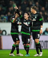 FUSSBALL   1. BUNDESLIGA    SAISON 2012/2013    13. Spieltag   VfL Wolfsburg - SV Werder Bremen                          24.11.2012 Sokratis Papastathopoulos, Zlatko Junuzovic und Sebastian Proedl (v.l, alle SV Werder Bremen) freuen sich nah dem Tor zum 0:1