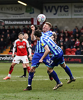 Blackpool's Matty Virtuecollides with team mate Blackpool's Taylor Moore as he heads the ball clear<br /> Photographer Lee Parker/CameraSport<br /> <br /> The EFL Sky Bet League One - Fleetwood Town v Blackpool - Saturday 7th March 2020 - Highbury Stadium - Fleetwood<br /> <br /> World Copyright © 2020 CameraSport. All rights reserved. 43 Linden Ave. Countesthorpe. Leicester. England. LE8 5PG - Tel: +44 (0) 116 277 4147 - admin@camerasport.com - www.camerasport.com