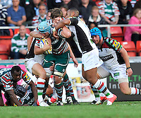 Leicester, England. Harlequins tackle Jordan Crane (Captain) of Leicester Tigers during the Aviva Premiership match between Leicester Tigers and Harlequins at Welford Road on September 22, 2012 in Leicester, England.