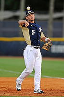 2 March 2012:  FIU utility player Oscar Aguirre (8) throws during pre-game warm-ups as the FIU Golden Panthers defeated the Brown University Bears, 6-5, at University Park Stadium in Miami, Florida.