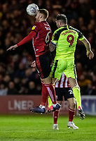 Bolton Wanderers' Daryl Murphy (right) competing in the air with Lincoln City's Cian Bolger <br /> <br /> Photographer Andrew Kearns/CameraSport<br /> <br /> The EFL Sky Bet League One - Lincoln City v Bolton Wanderers - Tuesday 14th January 2020  - LNER Stadium - Lincoln<br /> <br /> World Copyright © 2020 CameraSport. All rights reserved. 43 Linden Ave. Countesthorpe. Leicester. England. LE8 5PG - Tel: +44 (0) 116 277 4147 - admin@camerasport.com - www.camerasport.com